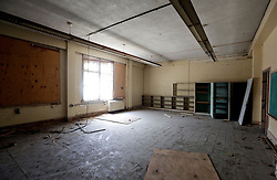 19 May 2015. New Orleans, Louisiana.<br /> The derelict Alfred C Priestley Junior High School.<br /> The old school in Pigeon Town has fallen into serious disrepair since 1980 when the last students and teachers left the building. The school was then used as office space and later as a warehouse until 1993. Hurricane Katrina only accelerated the decline. French charter school Lycée Francais recently purchased the crumbling wreck for $425,000 and have grand plans to return a middle and high school to the neighborhood. <br /> Photo; Charlie Varley/varleypix.com