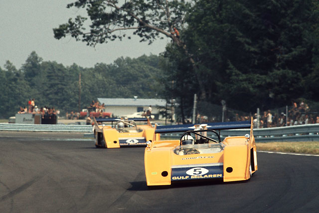 Denny Hulme leads Peter Revson in their McLaren M20s in the 1972 Watkins Glen Can-Am. This would be Hulme's and the McLaren factory's last-ever Can-Am victory.