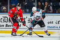 KELOWNA, BC - MARCH 02:  John Ludvig #15 of the Portland Winterhawks stick checks Leif Mattson #28 of the Kelowna Rockets  at Prospera Place on March 2, 2019 in Kelowna, Canada. (Photo by Marissa Baecker/Getty Images)