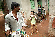 Budhia Singh, (right) 6, the famous Limca World Record marathoner, is carrying a just-purchased bottle of milk in front of the house where he now lives situated inside Salia Sahi slum (pop. 30.000) of Bhubaneswar, the capital of Orissa State, on Friday, May 16, 2008. On May 1, 2006, Budhia completed a record breaking 65 km run from Jagannath temple, Puri to Bhubaneswar. He was accompanied by his coach Biranchi Das and by the Central Reserve Police Force (CRPF). On 8th May 2006, a Government statement had ordered that he stopped running. The announcement came after doctors found the boy had high blood pressure and cardiological stress. As of 13th August 2007 Budhia's coach Biranchi Das was arrested by Indian police on suspicion of torture. Singh has accused his coach of beating him and withholding food. Das says Singh's family are making up charges as a result of a few petty rows. On April 13, Biranchi Das was shot dead in Bhubaneswar, in what is believed to be an event unconnected with Budhia, although the police is investigating the case and has made an arrest, a local goon named Raja Archary, which is now in police custody. **Italy and China Out**