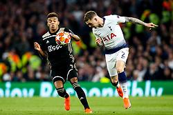 Kieran Trippier of Tottenham Hotspur heads the ball past David Neres of Ajax - Mandatory by-line: Robbie Stephenson/JMP - 30/04/2019 - FOOTBALL - Tottenham Hotspur Stadium - London, England - Tottenham Hotspur v Ajax - UEFA Champions League Semi-Final 1st Leg