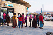 Herero and Himba women at in a queue at an ATM. Kaokoland, Namibia
