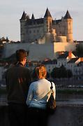 Chateau de Saumur along the river. A romantic couple. Saumur, Loire, France