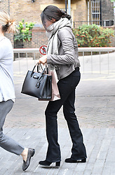 """EXCLUSIVE: **STRICTLY NO WEB UNTIL 1830 GMT 22ND NOV** Meghan Markle is spotted Christmas shopping in London, ahead of what many believe is her imminent engagement to Prince Harry. Wearing shades, Meghan looked stunning in tight black jeans, boots, a grey jacket and matching wrap-around scarf, as she was seen leaving a Heidi Klein designer beachwear store, possibly hinting at a winter holiday in the sun with her prince charming. The store is next to department store Peter Jones, on the Kings Road, which is an old stomping ground of soon-to-be sister-in-law Kate Middleton, Duchess of Cambridge. Meghan was clutching a £2,000 Prada handbag and a shopping bag from Sarah Chapman, which specialises in skin care. In fact, some Royal watchers believe the Meghan and Harry, who confirmed their long-distance relationship a year ago, are already secretly engaged - and wedding bells are just around the corner. It's believed 36-year-old Meghan is in London making final preparations for her permanent move across the Atlantic to set up home with Harry, 33 – along with her beloved dogs, labrador/shepherd mix Bogart and 17lb beagle Guy. The American actress has just finished filming her seventh and final season of the US legal drama Suits, in which she stars as lawyer Rachel Zane, in Toronto. Meghan's body double sparked mass excitement juts days ago when she posted a cryptic Instagram post. Nicky Bursic - who has been Meghan's stand-in on Suits for two years - posted a goodbye and congratulations message to the star on the social network that fans have taken of proof that both Meghan has quit Suits and that she is engaged to the royal. """"It's been an absolute pleasure and honour being your 'STAND-IN' for the last 2 seasons,"""" Nicky wrote. Though I've been on @suits_usa for 6 years, the latter 2 has been my most memorable. Wishing you all the happiness in the world Bella."""" She added a love heart emoji and one of a champagne glass toast alongside some highly revealing hashtags."""