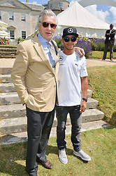 Left to right, ARNAUD BAMBERGER and LEWIS HAMILTON at the Cartier hosted Style et Lux at The Goodwood Festival of Speed at Goodwood House, West Sussex on 29th June 2014.
