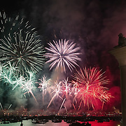 VENICE, ITALY - JULY 16:  Fireworks with the colours of the Italian flag lit St Mark's basin at the end of the first day of Redentore celebrations on July 16, 2011 in Venice, Italy. Redentore is one of the most loved celebrations by Venetians which is a remembrance of the end of the 1577 plague. Highlights of the celebration include the pontoon bridge extending across the Giudecca Canal, gatherings on boats in the St Mark's basin and spectacular fireworks on display.