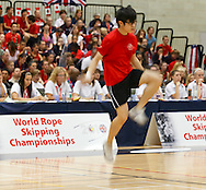 Loughborough, England - Saturday 31 July 2010: A Hong Kong competitor in action during the World Rope Skipping Championships held at Loughborough University, England. The championships run over 7 days and comprise junior categories for 12-14 year olds in the World Youth Tournament, 15-17 year olds male and female championships, and any age open championships. In the team competitions, 6 events are judged, the Single Rope Speed, Double Dutch Speed Relay, Single Rope Pair Freestyle, Single Rope Team Freestyle, Double Dutch Single Freestyle and Double Dutch Pair Freestyle. For more information check www.rs2010.org. Picture by Andrew Tobin/Picture It Now.