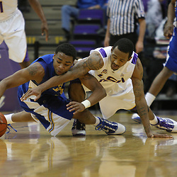 Jan 04, 2010; Baton Rouge, LA, USA;  McNeese State Cowboys forward Patrick Richard (left) and LSU Tigers guard Aaron Dotson (right) scramble for a loose ball during the first half at the Pete Maravich Assembly Center.  Mandatory Credit: Derick E. Hingle-US PRESSWIRE