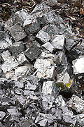 Recycling scrap metal dealer, dealing in ferrous and non-ferrous metals, compacted into cubes to stop environmental pollution