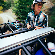 Carl Montoya - Nitro Gear & Axle shuttles Yuri Choufour, Rex Flake and Jay Goodrich to the top of the Tibbits single track near Leavenworth, Washington. (Rex Flake standing)