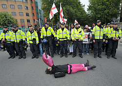 "© Licensed to London News Pictures.  10/09/2017; Bristol, UK. A woman is removed from the road by police, part of a Counter demonstrators' protest against a group called British and Immigrants United Against Terrorism who joined forces with another group called Gays Against Sharia to stage a demonstration in Bristol city centre numbering about 50 people. The counter-protest was called 'Stand Up To Racism and Bigotry'. A statement issued to oppose the march says that the demonstrators ""claim falsely that they are representing the views of the LGBT+ community in Bristol,"" adding: ""In fact, none of the organisers are LGBT+ and all the proposed speakers come from outside Bristol."" A heavy police presence Police with riot vans dogs and horses were in attendance. Police banned face coverings, masks, banners and flags 'that might incite hatred' ahead of today's protests. Picture credit : Simon Chapman/LNP"