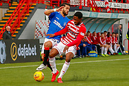 Lennard Sowah takes the ball from Rangers Daniel Candeias during the Ladbrokes Scottish Premiership match between Hamilton Academical FC and Rangers at The Hope CBD Stadium, Hamilton, Scotland on 24 February 2019.