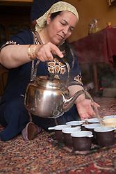 Middle East, Israel, Majdal Shams, Druze woman pouring tea.  MR