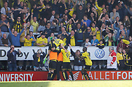 Burton Albion midfielder Michael Kightly (28) scores a goal 2-0 and celebrates during the EFL Sky Bet Championship match between Burton Albion and Leeds United at the Pirelli Stadium, Burton upon Trent, England on 22 April 2017. Photo by Richard Holmes.