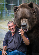 Otisville, New York - Jim Kowalczik with Jimmy, a 1,400-pound Kodiak bear, at the Orphaned Wildlife Center on Sept. 7, 2016. Jim Kowalczik and his wife Susan Kowalczik are licensed wildlife rehabilitators who run the center with the goal of providing safety and nurturing to animals that are truly orphaned and prepare them to be returned to a life in the wild.
