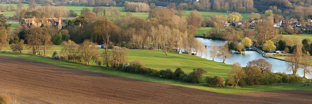 Spring sunset over the River Thames overlooking Mapledurham House and Weir from the Chiltern Hills, Uk