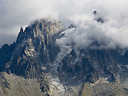 The Needles of Chamonix (Les Aiguilles du Chamonix), rise high above the city of Chamonix-Mont-Blanc, France, Europe.