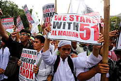 October 14, 2016 - Jakarta, Jakarta, Indonesia - Demo by Action Unit Islamic Organizations and Public Organizations starting Istiqlal mosque jakarta, headed the Criminal Investigation and ends in front of city hall jakarta. This demo demanding to bring an action and catch Ahok because they commit sacrilege against Islam. (Credit Image: © Denny Pohan via ZUMA Wire)