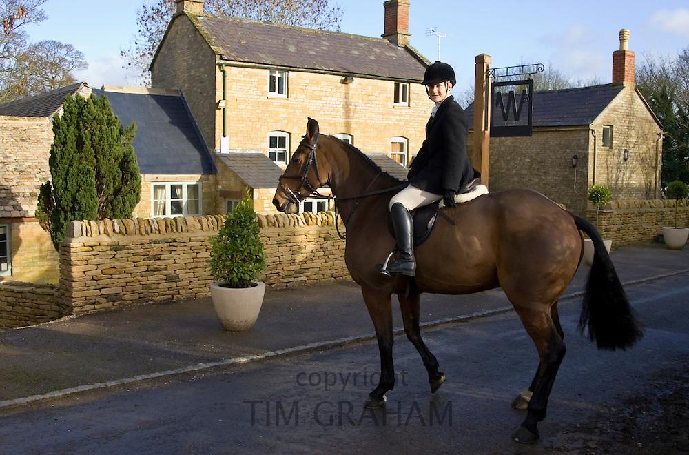 Rider outside Westcote Inn Pub, Nether Westcote, Oxfordshire / Gloucestershire border, The Cotswolds, UK