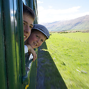 Harry Burgess, 15, (left) and his brother Jack Burgess, 12, riding on the Kingston Flyer vintage steam train at Saturday's relaunch of the historic locomotives at Fairlight near Queenstown, Central Otago, New Zealand, 29th October 2011. Photo Tim Clayton...