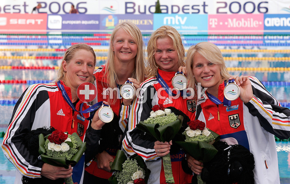 (L-R) Germany's Annika Liebs, Petra Dallmann, Britta Steffen and Daniela Goetz show their medals after winning the gold medal in the final of the Women's 4x100m freestyle relay in a new world record time at the European Swimming Championships in Budapest, Hungary, Monday, July 31, 2006. (Photo by Patrick B. Kraemer / MAGICPBK)