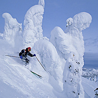 """SKIING, The Big Mountain, Montana. Scott Sederstrom (MR) skis beside """"snow ghost"""" above Hellroaring Canyon."""