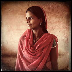 "iPhone portrait of Savita Daamor, 13, in a village outside of Banswara, Rajasthan, India, May 21, 2013. ""My father was saying he will get me married. I refused, I said, 'No. I won't get married.' I would not like it if I got married at a tender age,"" said Daamor. <br /> <br /> Under Indian law, children younger than 18 cannot marry. Yet in a number of India's states, at least half of all girls are married before they turn 18, according to statistics gathered in 2012 by the United Nations Population Fund (UNFPA). However, young girls in the Indian state of Rajasthan—and even a few boys—are getting some help in combatting child marriage. In villages throughout Tonk, Jaipur and Banswara districts, the Center for Unfolding Learning Potential, or CULP, uses its Pehchan Project to reach out to girls, generally between the ages of 9 and 14, who either left school early or never went at all. The education and confidence-building CULP offers have empowered youngsters to refuse forced marriages in favor of continuing their studies, and the nongovernmental organization has provided them with resources and advocates in their fight."