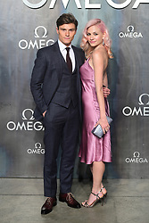 Oliver Cheshire and Pixie Lott attending the Lost in Space event to celebrate the 60th anniversary of the OMEGA Speedmaster held in the Turbine Hall, Tate Modern, 25 Sumner Street, Bankside, London.