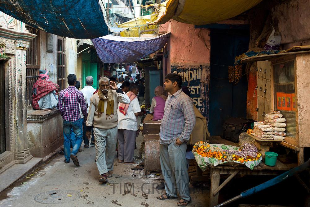 Indian people in alleyway in the holy city of Varanasi, Benares, Northern India
