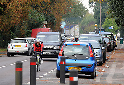 """© Licensed to London News Pictures. 14/10/2013<br /> Traffic on Tonbridge Road, Hildenborough,Kent.<br /> Double Olympic gold medallist Dame Kelly Holmes is facing opposition to her plans to open a cafe in a Kent village where she grew up. <br /> She has put in an application under business name """"Double Gold Enterprise Ltd""""  to Tonbridge and Malling Borough Council to redevelop a former newsagent's shop at 152-154  Tonbridge Road, Hildenborough,Kent.<br /> Some residents have said parking will be an issue as it is on a main road.<br /> The application is due to be discussed by Tonbridge and Malling Borough Council on 24 October.<br /> Photo credit :Grant Falvey/LNP"""