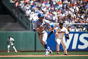 Los Angeles Dodgers second baseman Chris Taylor (3) runs to third base on a hit against the San Francisco Giants at AT&T Park in San Francisco, California, on April 27, 2017. (Stan Olszewski/Special to S.F. Examiner)