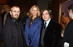 Left to right, RINGO STARR, his wife BARBARA BACH and artist GEORGE CONDO at an exhibition of paintings by artist George Condo entitled 'Religious Paintings' held at the Spruth Magers Lee Gallery, 12 Berkeley Street, London W1 on 12th October 2004.<br />