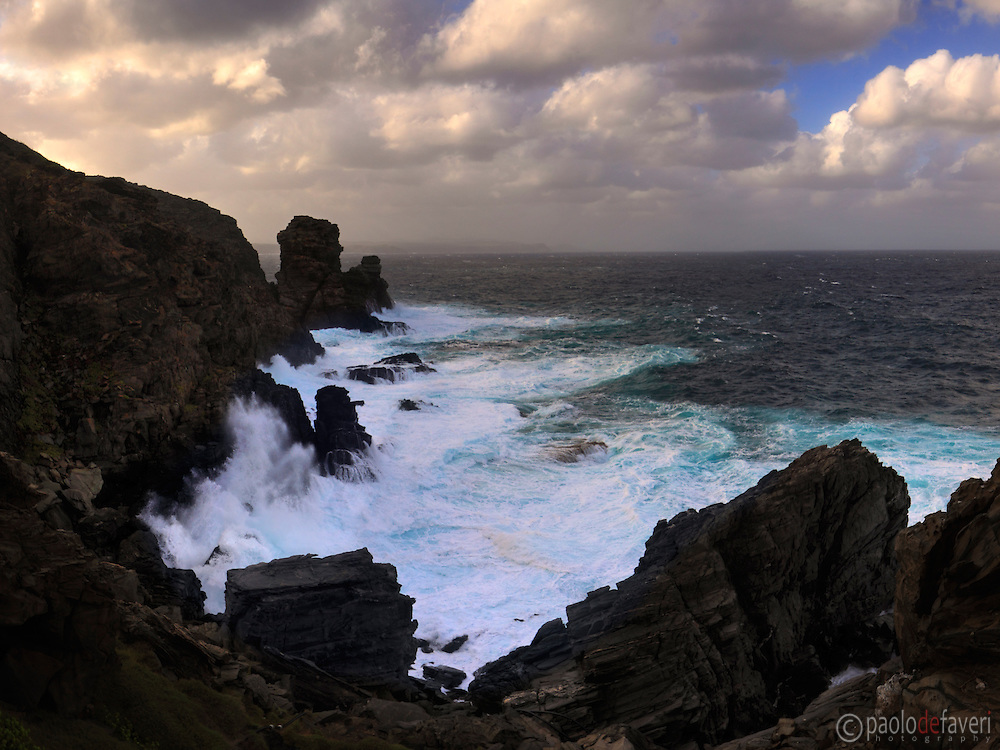 The rocky coast of Capo Falcone during a storm. Capo Falcone is a rocky promontory at the north-western tip of Sardinia, Italy, right in face of the Island of Asinara