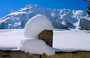 Klosters - Amongst the Silvretta group of the Swiss Alps. Deep snow on fencing