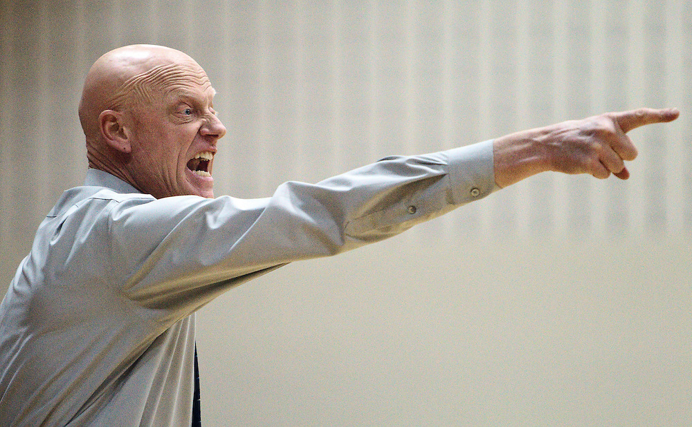 Ravenna's head coach Paul Beranek motivates the defenese in the second quarter of Thursday's game at Doniphan-Trumbull Public School. Ravenna went on to win 48-40. (Independent/Matt Dixon)