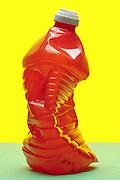 crushed red plastic bottle still life