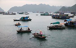 © Licensed to London News Pictures. 08/03/2014. Cat Ba Island, Vietnam. FILE PHOTO taken 21/04/2013 : A general view of boats and the coast off Cat Ba Island in Northern Vietnam. A Malaysian airlines flight MH370 went missing with 239 passengers on board somewhere in the South China Sea. Photo credit : Rob Arnold/LNP