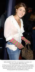 MISS AMBER NUTTALL at a party in London on 7th November 2002.PFB 129
