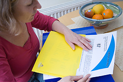 Woman looking at her houses energy rating certificate,