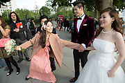 Chinese wedding party of friends and relatives descend upon the South Bank. The happy couple who were from Beijing had only been in London for one day, having travelled to the UK just to get married.