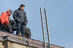 Tom Cruise climbs the Tate Modern tower filming a stunt for Mission Impossible Fallout in London. Tom battled the wind while helicopters circled overhead. 11 Feb 2018 Pictured: Tom Cruise. Photo credit: MEGA TheMegaAgency.com +1 888 505 6342