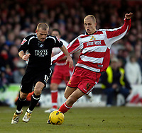 Photo: Jed Wee.<br />Doncaster Rovers v Swansea City. Coca Cola League 1.<br />17/12/2005.<br />Swansea's Andy Robinson (L) tries to take on Doncaster's Steve Roberts.