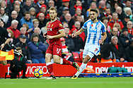 Ragnar Klavan of Liverpool (l) passes the ball back under pressure from Tommy Smith of Huddersfield Town. Premier League match, Liverpool v Huddersfield Town at the Anfield stadium in Liverpool, Merseyside on Saturday 28th October 2017.<br /> pic by Chris Stading, Andrew Orchard sports photography.
