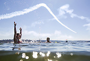 Swimmers in Lake Washington at Mount Baker Beach enjoy the Blue Angels practice, 2015. (Bettina Hansen / The Seattle Times)