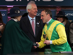 Princess Anne (left) presents Jockey Robbie Power with the Timico Gold Cup after his winning ride on Sizing John in the Timico Cheltenham Gold Cup Chase during Gold Cup Day of the 2017 Cheltenham Festival at Cheltenham Racecourse.