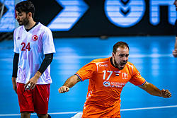 The Dutch handball player Ivo Steins in action during the European Championship qualifying match against Turkey in the Topsport Center Almere.