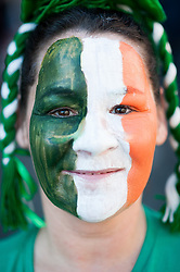 © Licensed to London News Pictures. 16/03/2014. London, UK. A Paddy's Day parade participant poses for a picture at the annual parade as it moves through London from Green Park to Trafalgar Square. Photo credit : David Tett/LNP