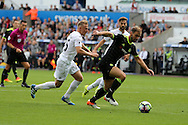Branislav Ivanovic of Chelsea breaks away from Stephen Kingsley of Swansea city. Premier league match, Swansea city v Chelsea at the Liberty Stadium in Swansea, South Wales on Sunday 11th Sept 2016.<br /> pic by  Andrew Orchard, Andrew Orchard sports photography.