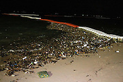 A tidal wave of trash washed up onto Pattaya Beach last night leaving tourists and locals wondering where it was all coming from.<br /> <br /> The ocean and beach were littered between Sois seven and nine. Crowds of tourists and local people gathered to try and find out what was going on.<br /> <br /> One local, who lived in the area long before the tourists came told reporters, 'It used to be lovely here. That's why people came to visit in the first place. I don't know where all this rubbish comes from. Is it us locals, or is it the visitors. Or does it come from somewhere else?'<br /> <br /> The image of Pattaya is further damaged by such scenes and the authorities are being urged to resolve the problem once and for all.<br /> ©Exclusivepix Media