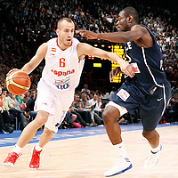 15 July 2012: Sergio Rodriguez of Team Spain drives past Yannick Bokolo of Team France during a pre-Olympic exhibition game won 75-70 by Spain over France, at the Palais Omnisports de Paris Bercy, in Paris, France.